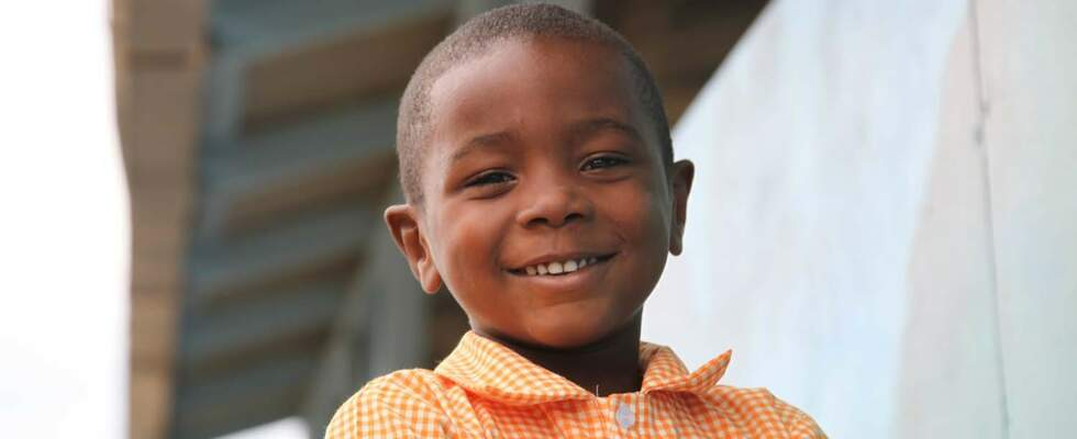 Portrait of a smiling boy in Haiti. (Source: Katja Anger)
