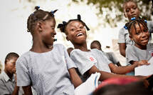 Laughing girls in a school in Haiti. (Source: Jakob Studnar)