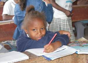 A girl in class, Ecuador. (Source: Kindernothilfe)