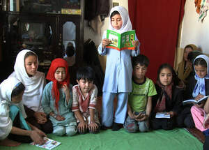 Children in Kabul, Afghanistan, reading books. (Source: tiva.tv)